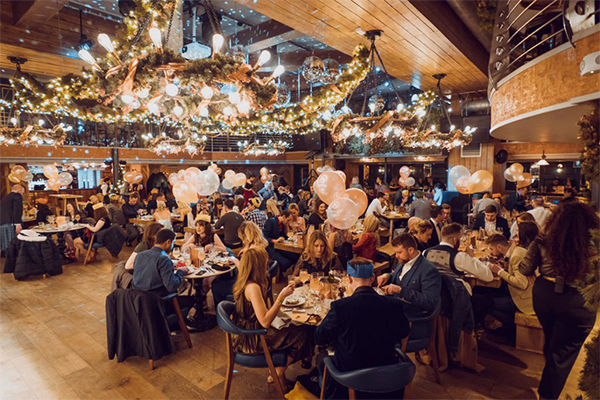 Customers enjoying food and drink in Brewhemia Edinburgh's Beer Palace during Christmas party