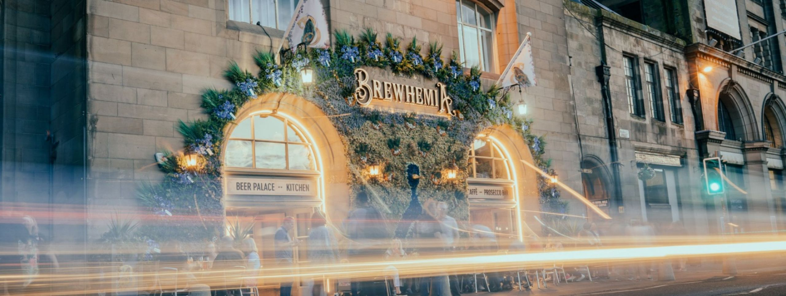 Exterior of Brewhemia Edinburgh on Market street, decorated with lights and the Peacock flowers