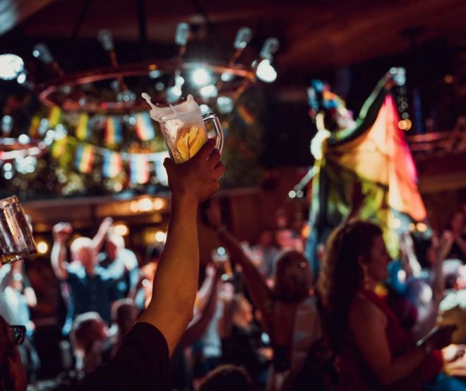 A pint of beer is lifted into the air during a Pride celebration at Brewhemia Ediburgh
